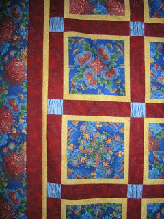 Four patch posie quilt, quilted by Angela Huffman