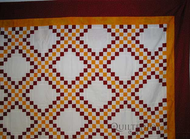 Jennie Beth asked Angela Huffman to custom quilt her fabulous Irish Chain quilt. Take a look at the two different quilting approaches I sent her and let me know which you like best!