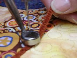 Couching with a Longarm Quilting Machine, photo courtesy of APQS