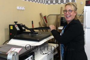 Pam uses a heat press to interface her T-shirts before making a T-Shirt Quilt