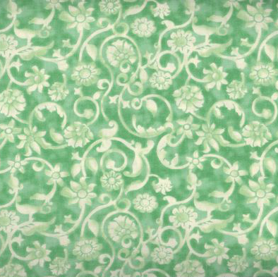 Dense tone on tone floral and vine pattern in light green. Available at QuiltedJoy.com