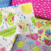 Adorable quilter's cotton flat folds with a spring theme