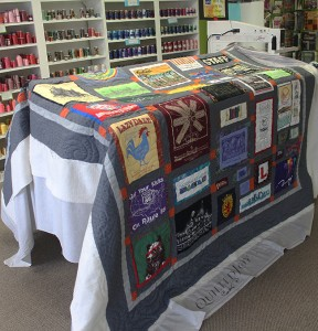 Joanne's Travel Shirts Quilt, quilted by Angela Huffman