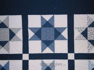Ohio Star Quilt with custom quilting by Angela Huffman - QuiltedJoy.com