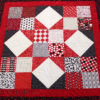 The square in a square is a common quilt block - QuiltedJoy.com