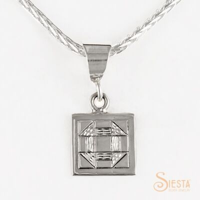 Mini Churn Dash sterling silver pendant by Siesta Silver Jewelry. Available at QuiltedJoy.com