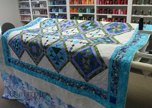 Longarm quilter Angela Huffman added a simple meander to Karee's two sampler quilts.