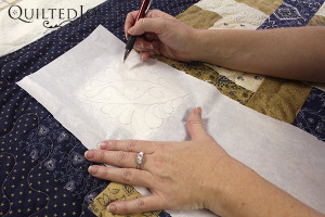 Do you sometimes look at a quilt and wonder how people decided what to quilt on it? Angela outlines the 5 best way to audition quilting designs. - QuiltedJoy.com