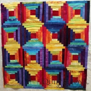 Pat Sturtzel's log cabin quilt with fabrics she dyed herself. Learn to dye your own fabrics at the Dip, Dye, and Dabble Day Camp at Quilted Joy Jan 21-23, 2016