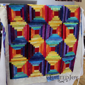 Pat Sturtzel's log cabin quilt after quilting. Learn from Pat how to dye your own fabrics at the Dip, Dye, and Dabble Day Camp at Quilted Joy Jan 21-23, 2016
