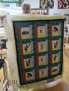 Paula brought a charity quilt for her rental certification class. - QuiltedJoy.com
