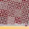 Linda made this Poinsettia Star Quilt. Quilting by Angela Huffman with the Clementis pantograph. - QuiltedJoy.com