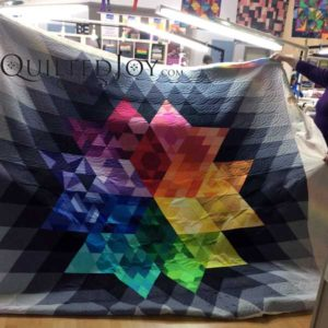 Gravity, a block of the month quilt. Quilted at QuiltedJoy.com