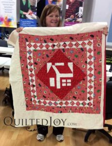 Schoolhouse block on a charity quilt for kids in need.