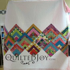 Angela Huffman at APQS dealer assisted renter Erin with her rinse and repeat quilt, modern log cabin quilt