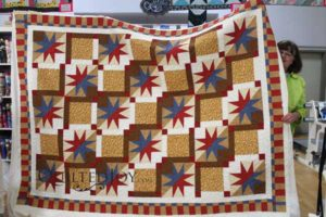 Beverly's variation on a 54-40 or Fight quilt block looks great with the Bountiful Feathers quilting design!