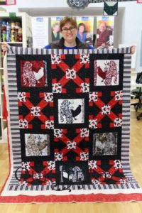 Tracie's roosters quilt with traditional baptist fan quilting design