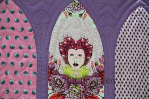 Longarm quilter Angela Huffma outlined Queen Elizabeth's face so that the design of the fabric did all of the talking.