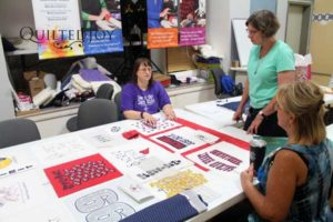 Liz discusses the different options for laying out T-shirts in a quilt at Quilted Joy