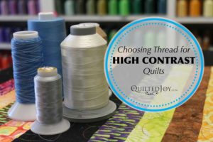 Quilters make many choices when quilting their quilts. Here, Angela discusses how to pick the perfect thread to quilt a high-contrast quilt.