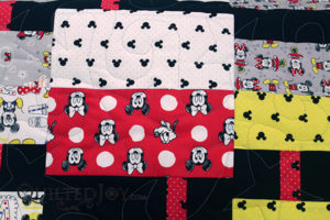 Close up of the quilting on Colleen's Mickey and Minnie Mouse quilt for her grand kids