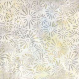 "This lovely 108"" wide batik from Wilmington Prints has a fun flower print in grey."