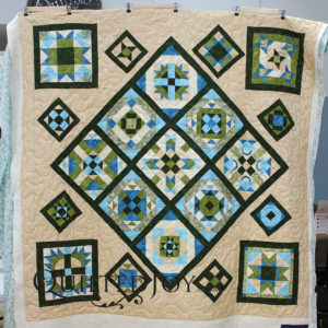 Karee put her blocks on point for a fresh take on a sampler quilt. Quilted by Angela Huffman.