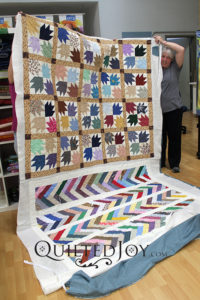 Two quilts on one backing fabric