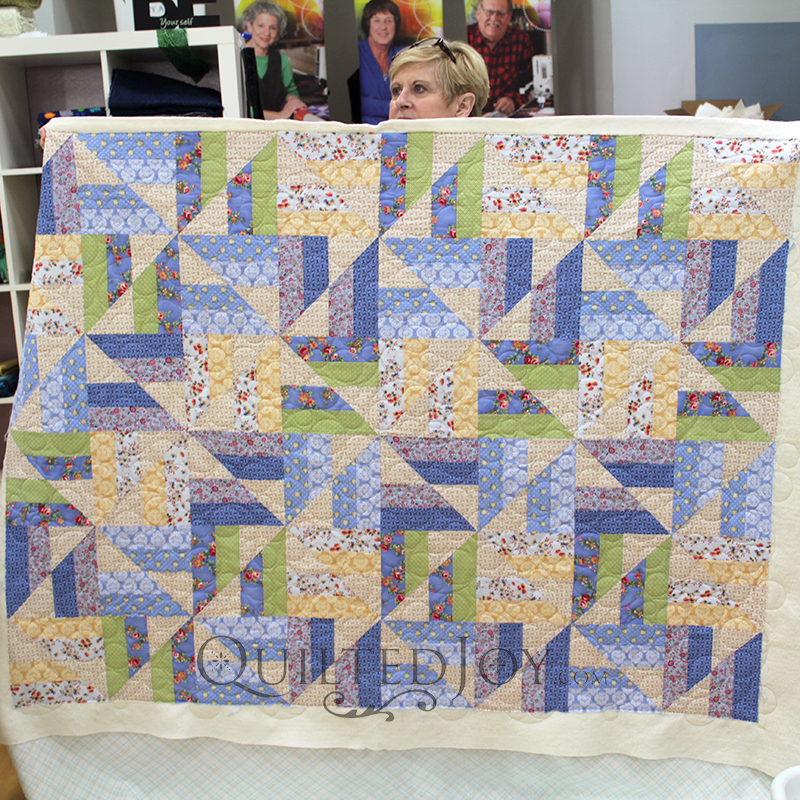 Beverly quilted this fun strip sets quilt with a bubbles design board.
