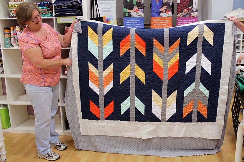Judy quilted her super cute Arrow quilt with a meander design board.