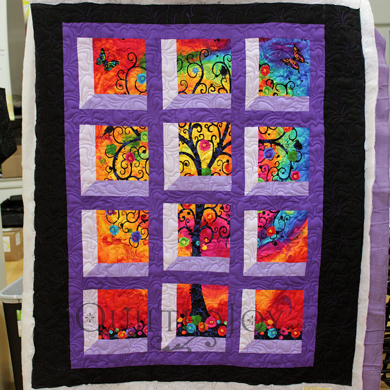 Melanie's Attic Window quilt was made with the Fantasia Tree panel.