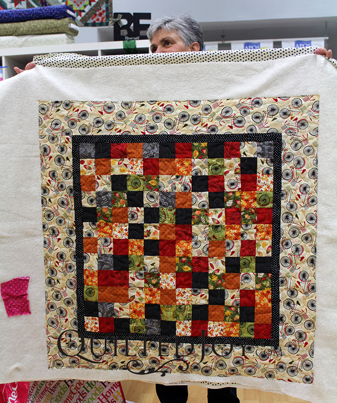 Colleen's cute autumn themed quilt also has bikes, one of her favorite fall time activities!