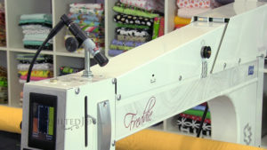 How to use the laser light on the front of your APQS longarm quilting machine