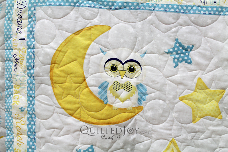 """Peggy found the perfect fabric panel for her baby quilt with cute little animals and the phrase, """"I love you to the moon and back."""" See how Angela quilted this adorable little quilt!"""