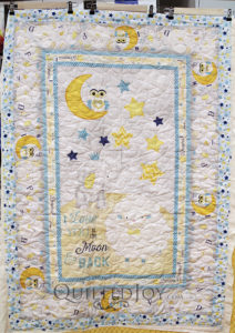 "Peggy found the perfect fabric panel for her baby quilt with cute little animals and the phrase, ""I love you to the moon and back."" See how Angela quilted this adorable little quilt!"