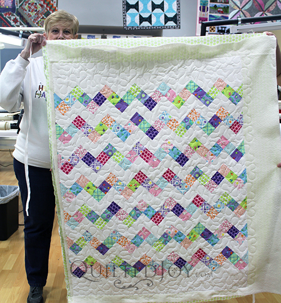 Beverly's zig zag quilt would be the perfect scrap buster! She quilted this with the meander design board at Quilted Joy.