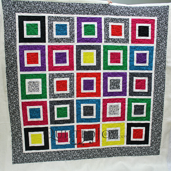 Colleen used fun alphabet fabrics to make a super cute quilt for her grandkids! She played with the quilting and even added letters and words throughout!