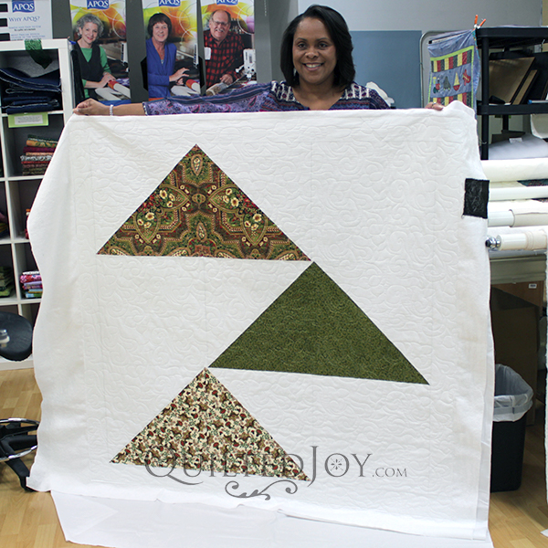 Kecia super-sized some Flying Geese blocks to make a fun modern quilt.