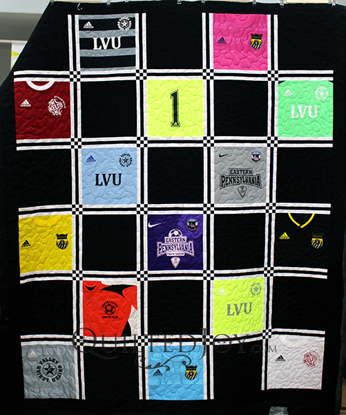 Sue asked me to quilt this awesome soccer jersey quilt! I was so impressed with the way she played with the sashing and cornerstones, and how she cut some of the jerseys in really surprising ways.
