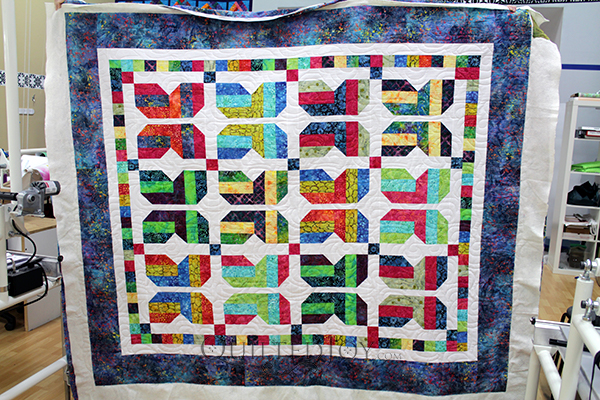 Carol quilted her Strip Butterflies quilt at Quilted Joy