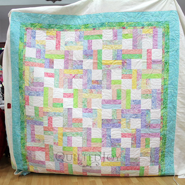AnnaMaria made this Split Rail Fence quilt with pastel batik fabrics.