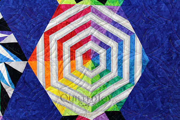 Cheri made the stunning Arcadia Ave block of the month quilt and asked me to quilt it for her. She chose a fun spiral pantograph with a rainbow variegated thread for a little extra pizzazz!