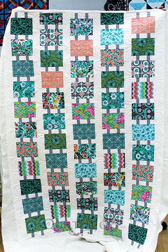 I love the colors in Emily's modern ladder quilt.