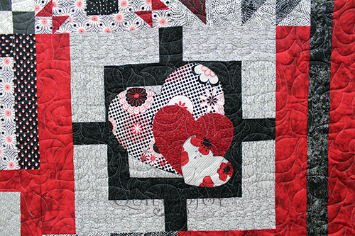 Jennifer's MASSIVE red, black, and white sampler quilt.
