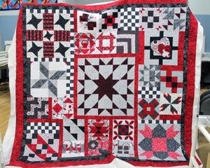 Jennifer's MASSIVE red, black, and white sampler quilt.