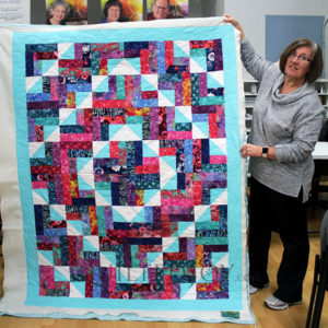 Judy free motion quilted this gorgeous quilt on an APQS longarm quilting machine at Quilted Joy