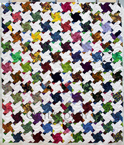 Take a look at Anita's quilt with tessellating pinwheel blocks. She asked me to quilt this with a swirly edge to edge design to mimic the motion in her top.