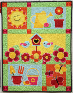 Learn to Machine Quilt on your home sewing machine during the Machine Quilting Primer: Wholecloth Baby Quilt Class