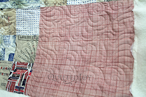 Detail of Oh My Feathers pantograph quilted on a quilt