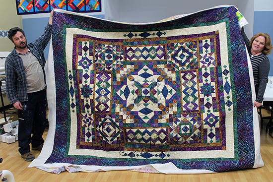Rhonda's colorful batik sampler quilt, quilted at Quilted Joy